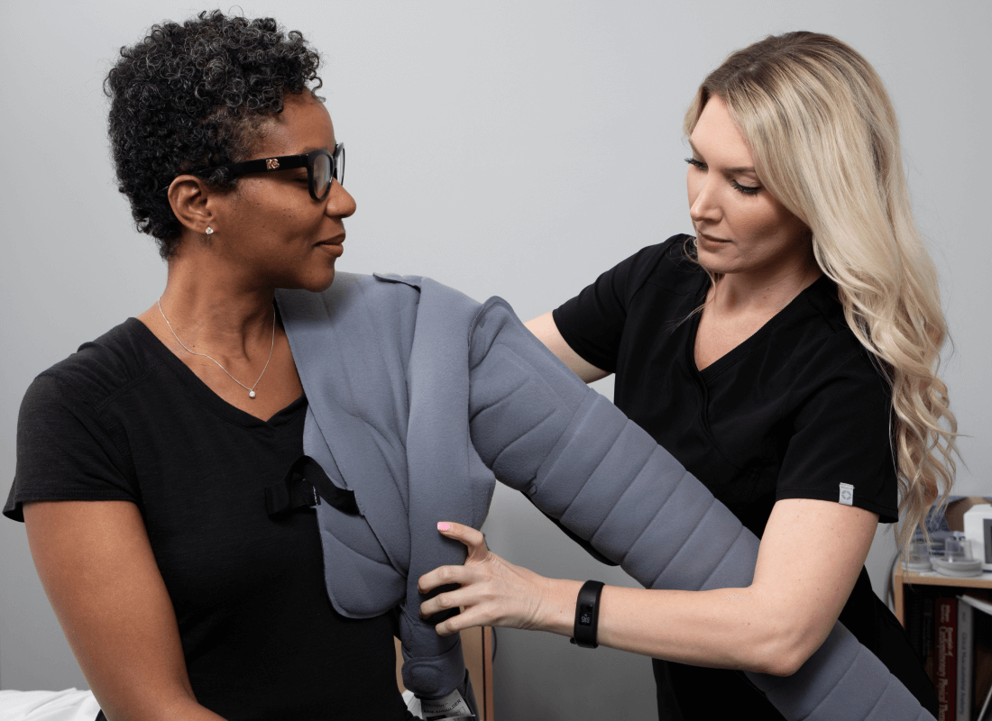 Flexitouch Plus Lymphedema Therapy Patient Receiving Help from Clinician